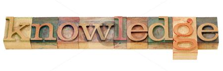 Knowledge word in letterpress type stock photo, knowledge  - isolated word in vintage wood letterpress printing blocks by Marek Uliasz