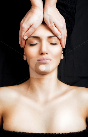 Facial massage stock photo, Beautiful female receiving relaxing facial massage at spa, eyes closed by vilevi