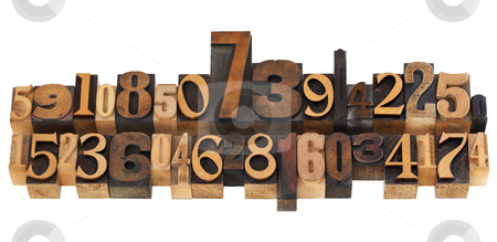 Random numbers in letterpress type stock photo, numerical concept - two rows of random numbers - isolated vintage wood letterpress printing blocks by Marek Uliasz