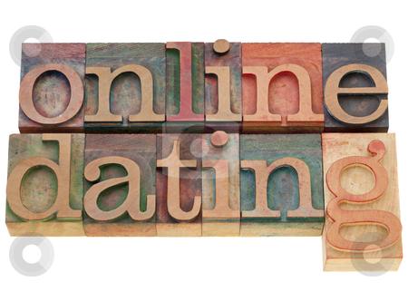 Online dating stock photo, online dating - isolated words in vintage wood letterpress printing blocks by Marek Uliasz