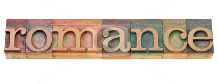 Romance in letterpress type stock photo, romance - isolated word in vintage wood letterpress printing blocks by Marek Uliasz