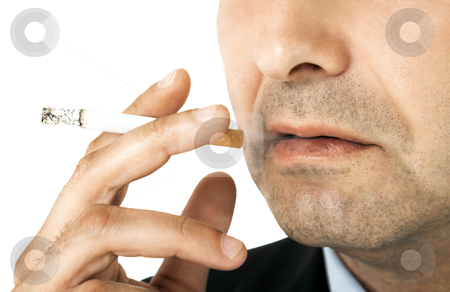 Cigarette smoking stock photo, Cropped image of man holding cigarette in his hand, close-up on it and mouth by vilevi