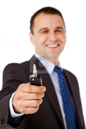 Car key stock photo, Portrait of happy businessman handing car key, focus on it by vilevi