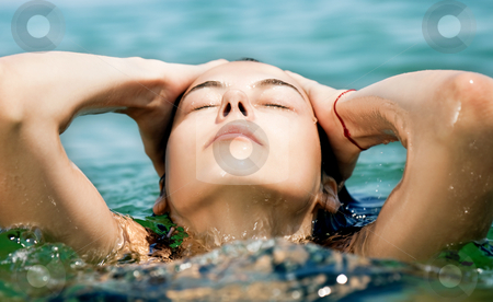 Female enjoing sea stock photo, Close-up of young female face enjoying sea water by vilevi