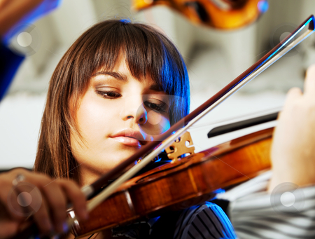 Beautiful violinist playing stock photo, portrait of a beautiful young violinist playing indoors by vilevi