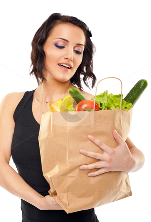 Woman holding grocery bag stock photo, Successful shopping by vilevi