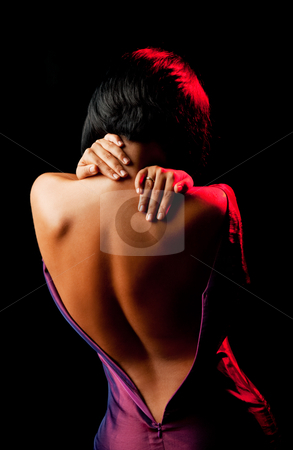 Undressing female stock photo, female seen from the back, undressing and holding her neck by vilevi