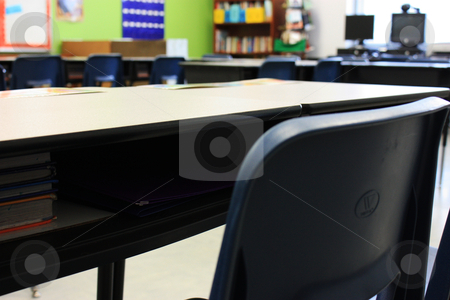 Desk in a classroom stock photo, A desk filled with books waiting for kids to start back to school by photolady