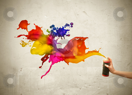 Colors stock photo, Woman&#039;s hand spraying colors on a wall by olly4