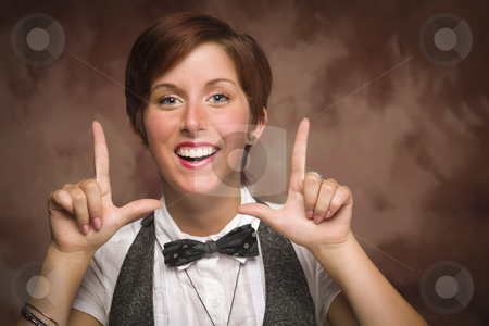 Pretty Young Adult Female Framing Face with Fingers stock photo, Pretty Smiling Young Red Haired Adult Female Framing Face with Fingers Isolated on a Muslin Background. by Andy Dean