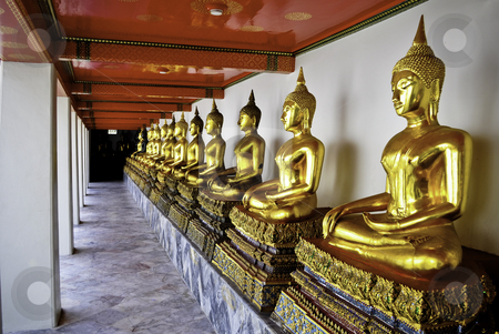Golden Thai Buddhas stock photo, A row of gold Thai buddhas in Bangkok, Thailand by elemery
