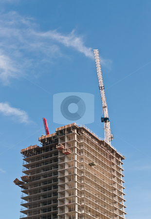 High Rise Building Under Construction stock photo, A high rise building under construction with tower crane. by Brian Guest