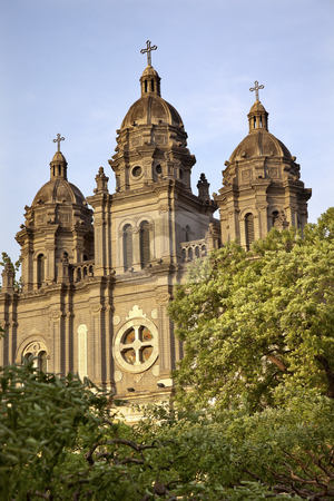St. Joseph Church Wangfujing Cathedral Facade Green Trees Basili stock photo, St. Joseph Wangfujing Cathedral, Basilica, Facade Green Trees Church Beijing China.  Very famous Catholic Church built in 1655 and in Boxer Rebellion  by William Perry