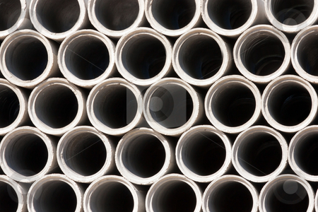 Cement Pipes stock photo, pattern of stacked concrete drainage pipes background  by Paulo M.F. Pires
