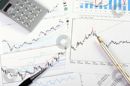 Charts and graphs of sales  stock photo, charts and graphs of sales of securities - workplace successful business man by Sergey Nivens