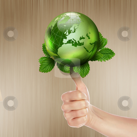 Green earth with growing plant stock photo, human hands holding green earth with a growing plant by Sergey Nivens