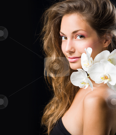 Gorgeous brunette closeup beauty shot. stock photo, Gorgeous brunette closeup beauty shot with white orchid. by exvivo
