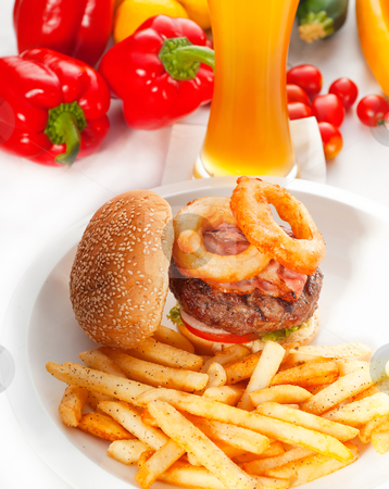 Classic hamburger sandwich and fries stock photo, classic american hamburger sandwich with onion rings and french fries,glass of  beer and fresh vegetables on background,  MORE DELICIOUS FOOD ON PORTFOLIO by Francesco Perre