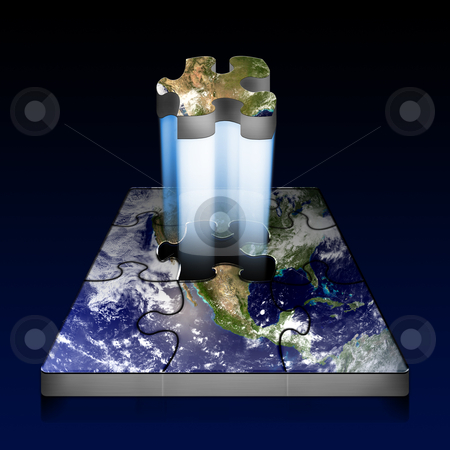 Earth Puzzle stock photo, A planet Earth puzzle with the last piece in the process of being placed in.  by macropixel