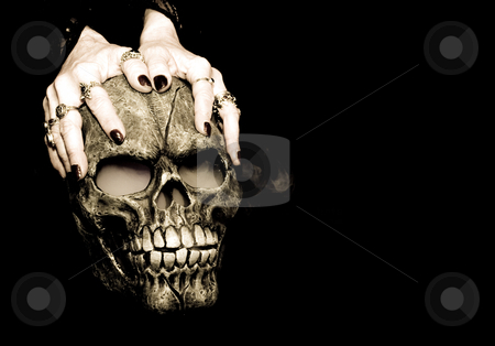Hands and skull stock photo, A Halloween prop skull with fog coming from it's eyes and nose being held by a woman's hands. by Cora Reed