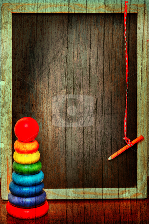 Grunge blackboard and pyramid stock photo, empty grunge blackboard in a wooden texture antique frame with a pencil on a string next to a colorful  pyramid. by lubavnel