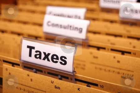 Taxes stock photo, tax or taxes concept with word on business folder index by Gunnar Pippel