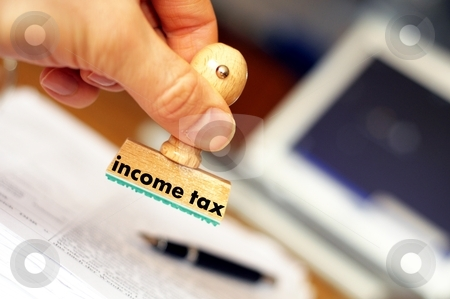 Income tax stock photo, income tax concept with stamp in office showing bureaucracy by Gunnar Pippel