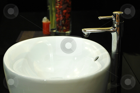 Wash Basin stock photo, A white wash basin with contemporary tap by smarnad