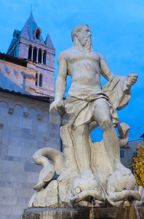 Carrara, cathedral and statue stock photo, Carrara (Tuscany, Italy), the ancient cathedral, exterior and statue  of Neptune (by Bandinelli, 16th century) at evening by clodio