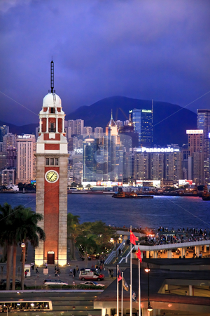 Hong Kong Clock Tower and Harbor at Night from Kowloon Ferry stock photo, Hong Kong Clock Tower and Harbor at Night from Kowloon Star Ferry Reflection by William Perry