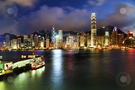 Hong Kong Harbor at Night from Kowloon Ferry stock photo, Hong Kong Harbor at Night from Kowloon Star Ferry Reflection by William Perry