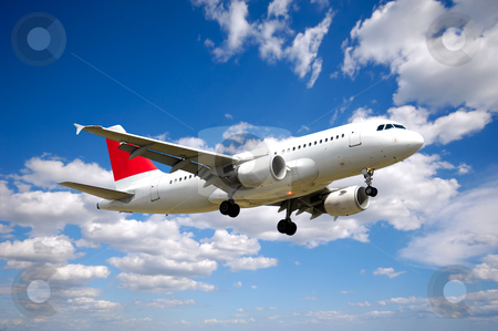 Air travel stock photo, Plane and cloudscape and blue sky by Lars Christensen