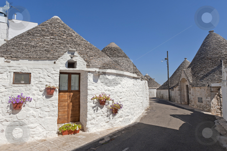 Alberobello (Bari, Puglia, Italy): Street in the trulli town stock photo, Alberobello (Bari, Puglia, Italy): Street in the trulli town by clodio