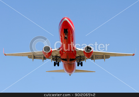 Red plane stock photo, Red plane is going to land  by Lars Christensen