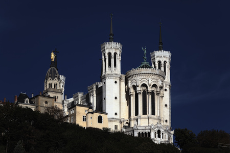 cathedral by night stock photo, Lyon Cathedral in the morning blue sky  by vwalakte