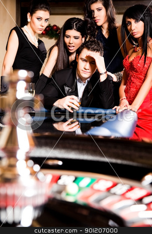 group zero roulette casino stock photo, Group of young people playing roulette at casino, looking disappointed by vilevi