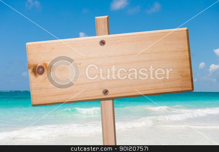 Wood sign in the beach. stock photo, Wood sign in the beach, with clipping path. by Pablo Caridad