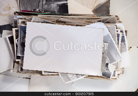 Old photo stock photo, Stack of old photos with one blank photo for your image. by Ints Vikmanis