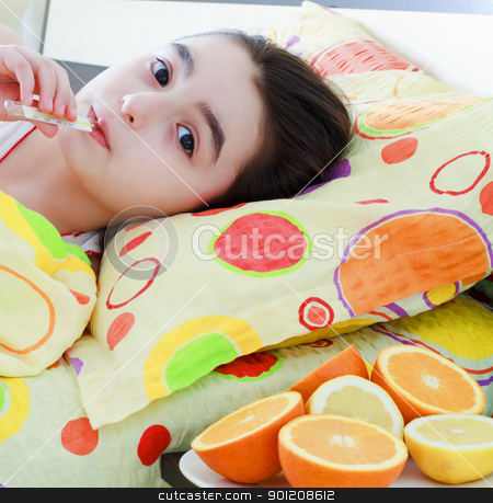 Sick little girl with a thermometer in bed stock photo, Sick little 7 years old girl with a thermometer in bed by manaemedia
