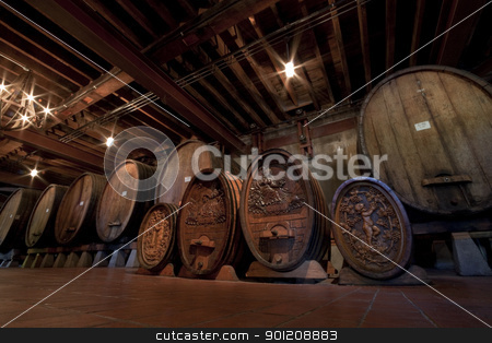 Historic Wine Barrels stock photo, A row of very old historic wine barrels by Kevin Tietz