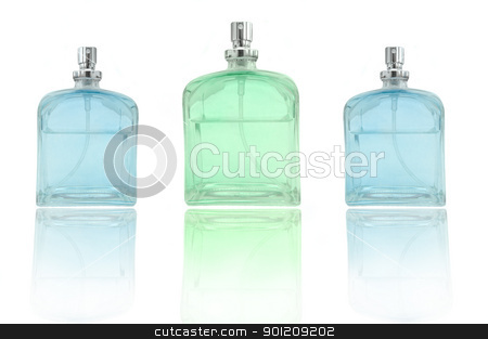 Perfume trio stock photo, low level angle capturing three perfume bottles arranged over white and reflecting into foreground. by Samantha Craddock