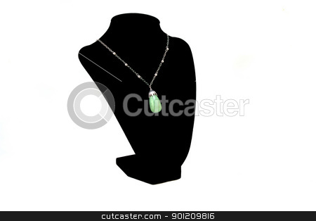 Jade stock photo, Green Jade tear drop necklace on black neck stand by Jack Schiffer