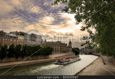 Touristic boat on Seine river in Paris, France. stock photo, Touristic boat passing by Seine river along historical buildings in Paris, France by Rostislav Glinsky