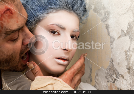 Vampire biting woman stock photo, Close-up of male vampire biting young woman's neck by vilevi