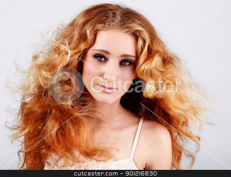 red hair girl stock photo, beautiful teenage girl with red blowing hair and blue eyes on grey studio background by lubavnel