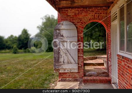 Open Wooden Door In Brick Wall To Garden Stock Photo