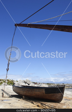 wooden boat moored by sea stock photo, crane and wooden fishing boat on edge of sea by Stephen Clarke
