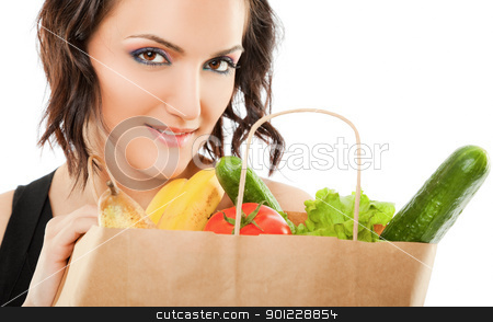 Female recycled grocery bag stock photo, young female holding paper shopping bag full of groceries, looking at camera by vilevi