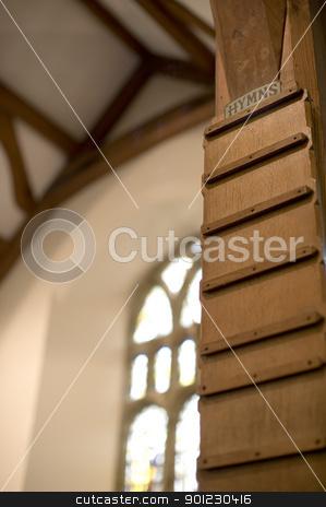 church hymn board stock photo, blank wooden hymn board in a gothic style church by Stephen Gibson