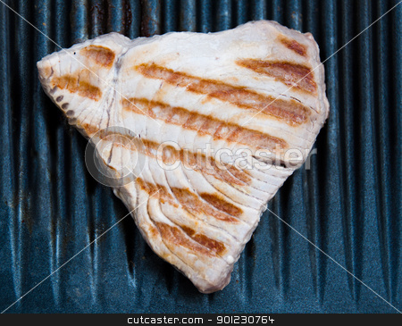 Tuna Steak Cooking On A Grill stock photo, Tuna fish steak cooking on a grill by Frank G?